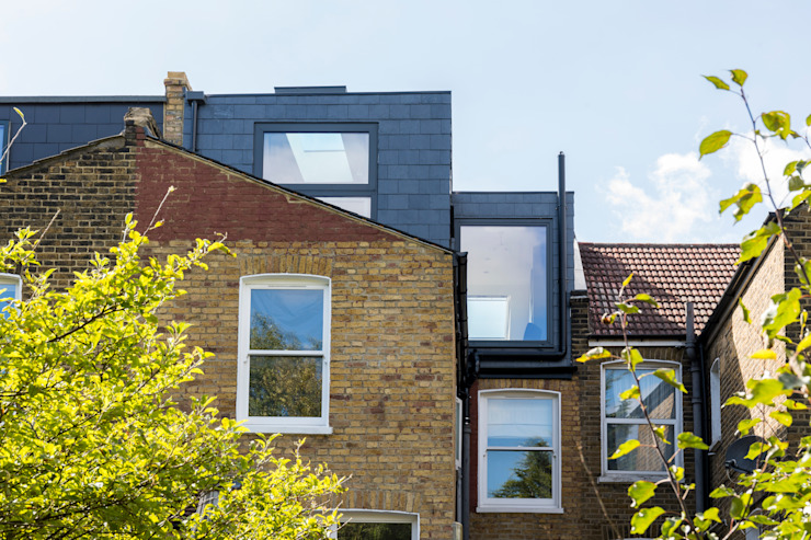 Conversion d'un loft en forme de L par l'urbaniste Architecture Briques modernes