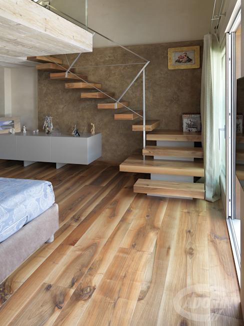 Idées pour combiner escaliers et parquet par Cadorin Group Srl - Parquet de qualité supérieure moderne