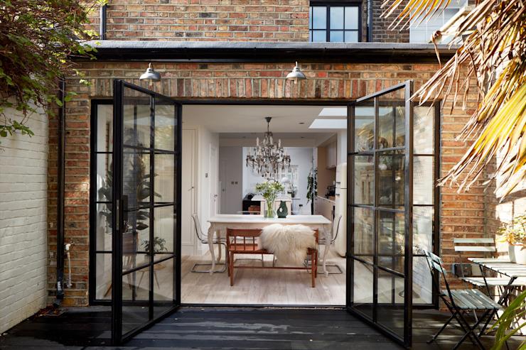 Extension de la maison Salle à manger moderne par l'urbaniste Architecture Verre moderne