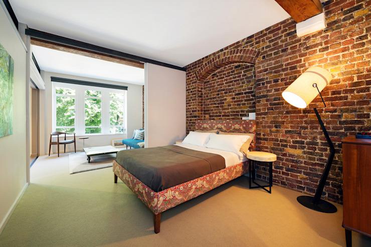 Chambre à coucher de style industriel par homify Industrial