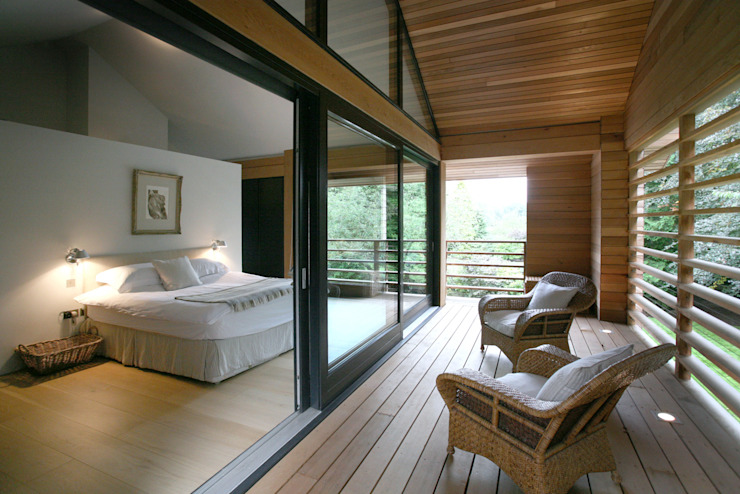 Chambre en bois de cèdre de style éclectique par Tye Architects Eclectic