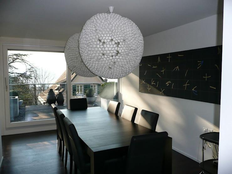 Zurich Appartement Salle à manger de style éclectique par 4D Studio Architectes et décorateurs d'intérieur éclectiques