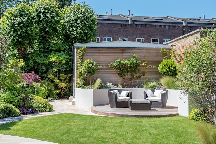 Un jardin familial contemporain orienté vers le sud Jardin moderne par Kate Eyre Garden Design Modern