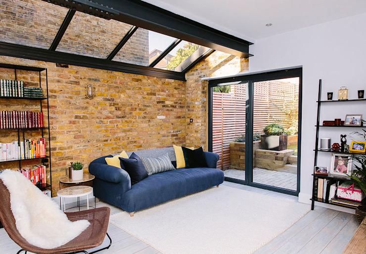 Salle de séjour moderne Salle de séjour moderne par Resi Architects à Londres Briques modernes