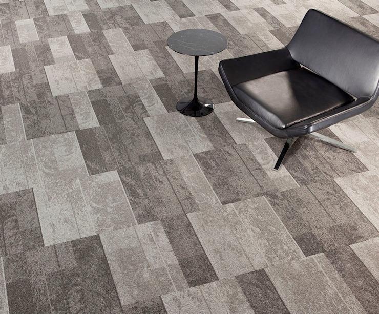 Un design étonnant avec des dalles de tapis : industriel par Industasia, Industriel