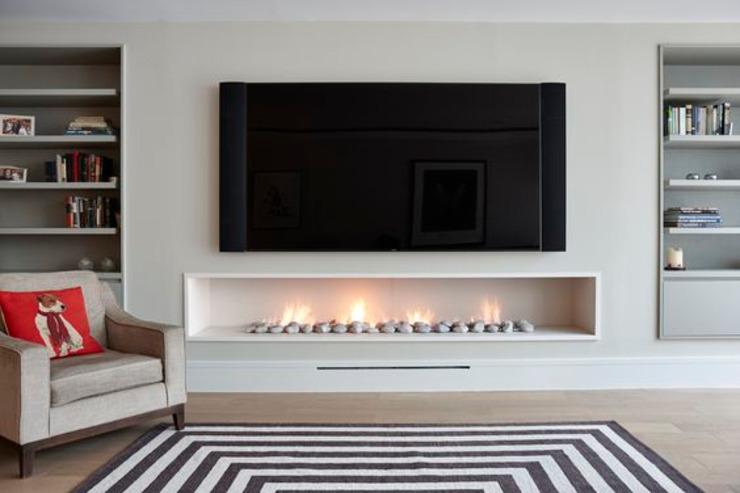 Trou dans la cheminée à gaz murale, style contemporain, moderne. Salon moderne par The Platonic Fireplace Company Modern Limestone