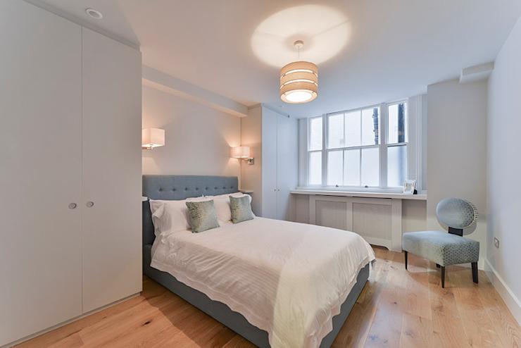 Chambre à coucher Chambre à coucher de style moderne par homify Modern