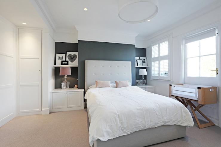 L'époque édouardienne rencontre le contemporain ; la maison de la famille Teddington PAD ARCHITECTES Chambre à coucher de style moderne