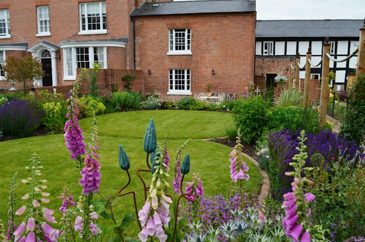 Pelouses circulaires et plantations traditionnelles Paysages uniques Jardin de style champêtre